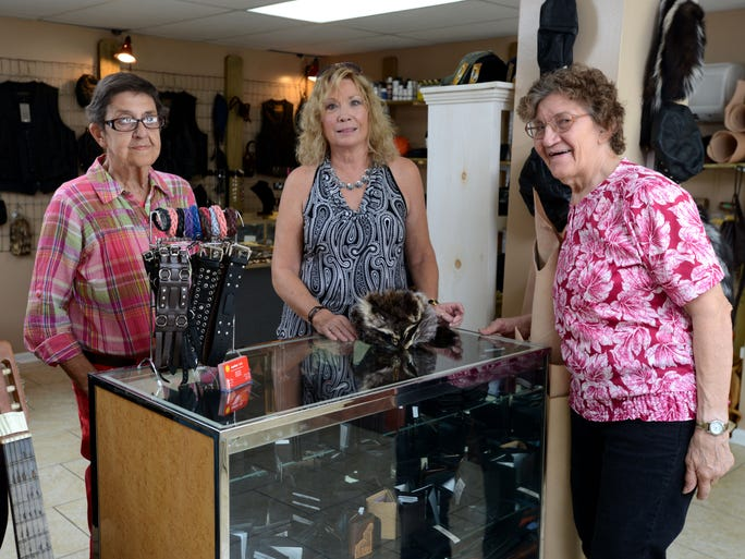 Leather 4-U owners Dee Rouse, left, and Esther Murray, right, are photographed with store manager Jeannie Cotten at the store at 6422 East Highway 90 in Milton. The leather shop offers products ranging from chaps to wallets and service like cleaning and repairs.