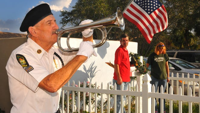 Richard Christie, of American Legion Post 117 Honor Guard, plays taps during a memorial for Brevard's homeless who passed away in 2017. The event is traditionally held on Dec. 21, the longest night of the year.