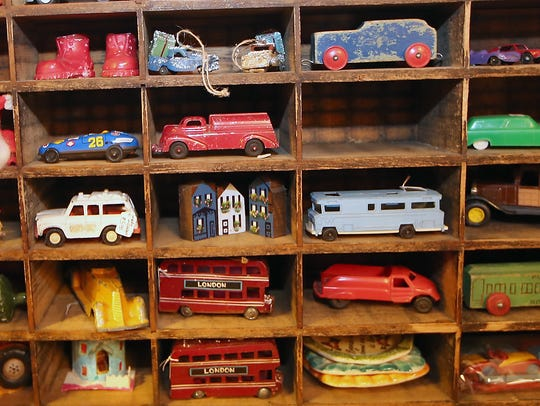 Vintage toy cars and knickknacks fill a shelf at Bob and Carolee Pederson's Christmas House.