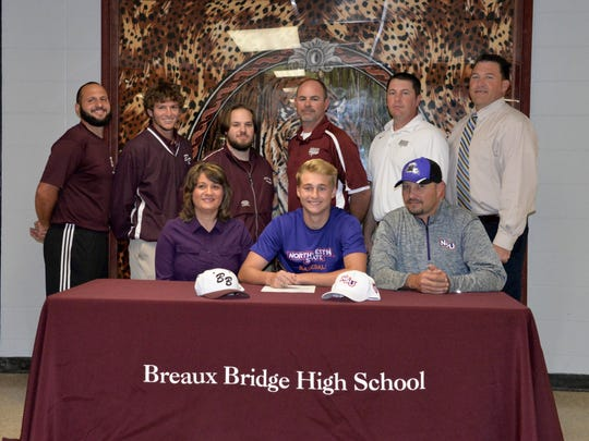 Breaux Bridge catcher Tyler Thibodeaux signs his national letter of intent with the Northwestern State Demons baseball program at the school.