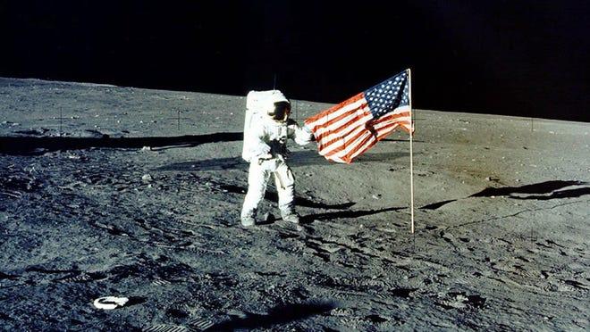 "Apollo 12 mission commander Charles P. ""Pete"" Conrad walks on the moon in 1969."