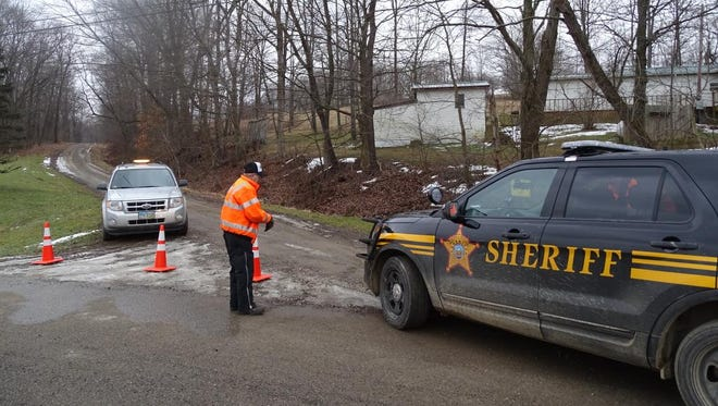 The Coshocton County Sheriff's Office arrived at the scene where the car and remains of Doyle and Lillian Chumney were found Thursday afternoon on Township Road 244.