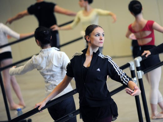 Dancers perform exercises at the barre during a competitor class on Thursday at Belhaven University's Bitsy Irby Visual Arts and Dance Centerin preparation for the upcoming USA International Ballet Competition which kicks off this Saturday at Thalia Mara Hall in Jackson.