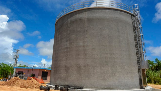 Construction work continues on the completion of Guam Waterworks Authority's Chaot water tank #1 in the hills of Ordot on May 28. The concrete tank at the site can hold 500,000 gallons of water, said Garrett Yeoh, GWA senior engineer.