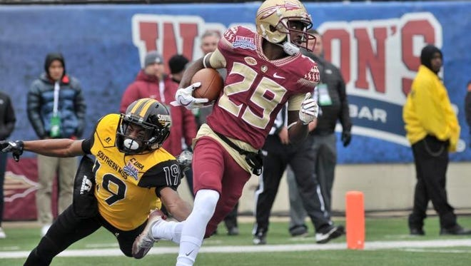 lorida State Seminoles wide receiver D.J. Matthews (29) carries the ball against Southern Miss Golden Eagles defensive back Curtis Mikell (19) during the first half in the 2017 Independence Bowl at Independence Stadium.