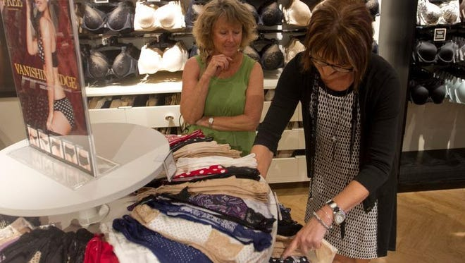 Colleen Monfort gets help from Soma assistant manager Janet Weir at the Bell Tower Shops location on Tuesday.
