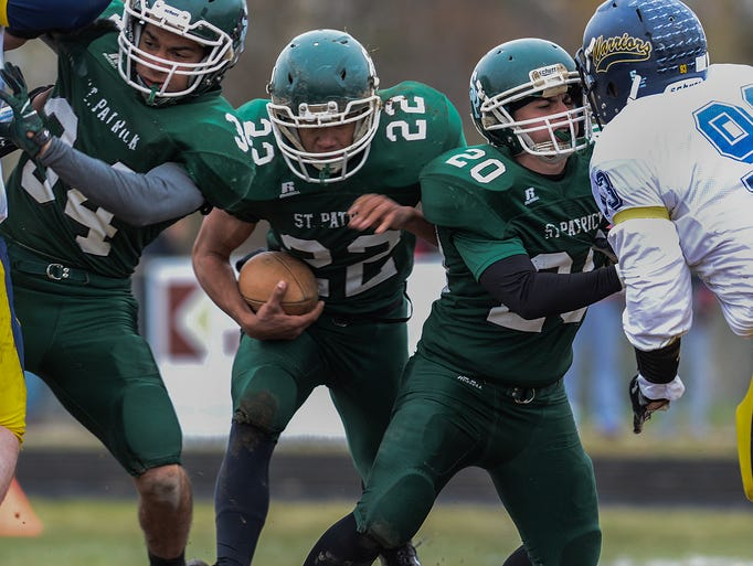 Portland St. Patrick's Isaiah Smith (34) and Bret Weller
