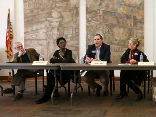 Springfield school board candidates, from left, Charles Taylor, Michelle Gavel, Allen Kunkel and Alina Lehnert participate in a NAACP forum at the Midtown Carnegie Library on Saturday, Mar. 19, 2016.