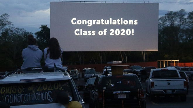 Nauset graduates are greeted with words worth repeating at the Wellfleet Drive-In on Sunday night.
