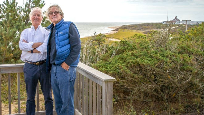 Sleuths Jack Clarke, left, and Greg O'Brien at the Eastham 'VIP' cottage where John Ehrlichman sanctioned the Ellsberg/Fielding break-in.  In this special report, Clarke reveals he was The Cape Codder's source in a 1974 article reporting that Ehrlichman's instructions originated in the Eastham dunes.  O'Brien wrote the story.