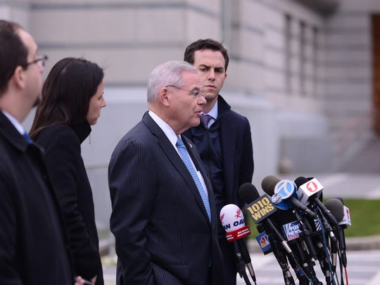 U.S. Sen. Bob Menendez speaks to the media as he leaves the Martin Luther King Jr. Federal Courthouse in Newark on Wednesday, November 15, 2017.