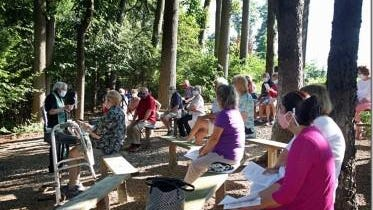 The Rev. Paul Gaston (left), rector at St. Mark's Episcopal Church in Canton, has been conducting services this summer at their outdoor chapel chapel, which was built by an Eagle Scout in the 1990s.