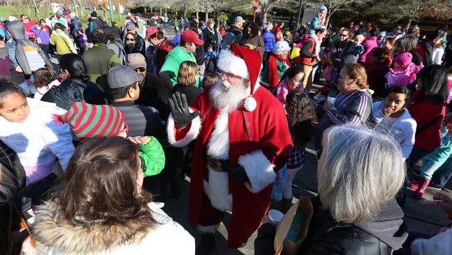 Santa arrives in Salem aboard the Carousel Express at noon Friday, Nov. 23.