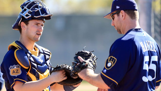Andrew Susac (left), working with bullpen catcher Marcus Hanel in spring training, suffered a muscle strain in his upper back and then cluster headaches.