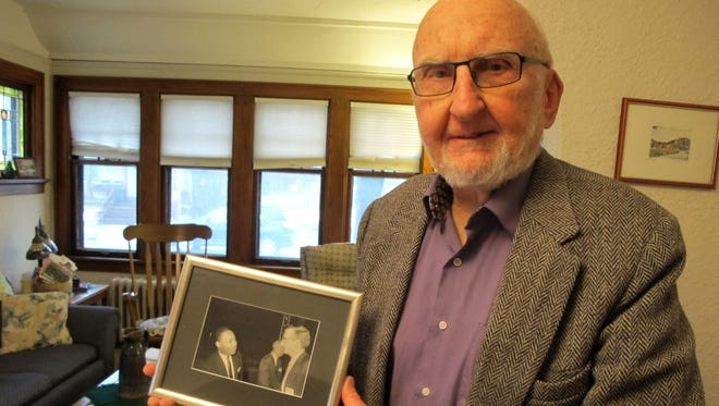 Rev. Joe Ellwanger holds a photo of himself and Dr. Martin Luther King. Ellwanger was a pastor of an African-American congregation in Birmingham from 1958 to 1967 and met King on several occasions. Ellwanger moved to Milwaukee in 1967.