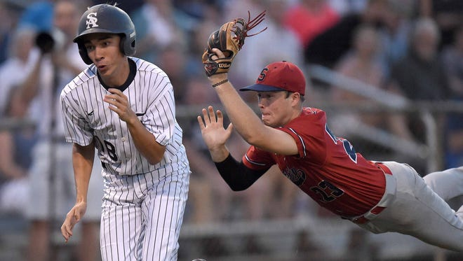 Seminary's Landry McQueen (23) runs down St. Andrew's Seth McCaughan (18) preventing him from scoring on Thursday, May 10, 2018, in game one of the MHSAA Class 3A South State Baseball Championship at St. Andrew's Episcopal School in Ridgeland, Miss.
