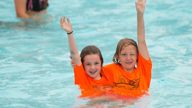 Children from Camp Wallace in Knoxville find their buddies at a giant swim lesson held by Dollywood's Splash Country in its wave pool at its annual water safety day Thursday, June 21, 2018.