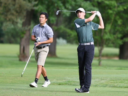 Regis's Casey Humphreys tees off during the first day of the OSAA 3A/2A/1A State Golf Tournament on Monday, May 16, 2016, at Emerald Valley Golf Club in Creswell.