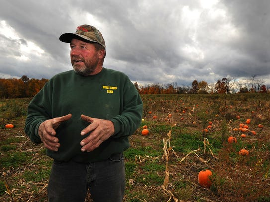 John Boyer explains how he grows a variety of pumpkins