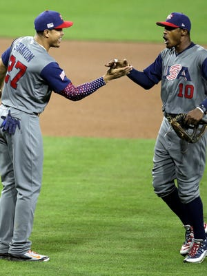 Giancarlo Stanton celebrates with teammate Adam Jones after their heroics keyed Team USA's World Baseball Classic victory over the Dominican Republic.