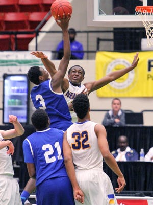 Cardinal Newman's Abdul Dial tries to block Godby's Quan Jackson from scoring during the 2015 FHSAA Boys 4A Basketball Thursday February 26, 2015 in Lakeland, FL. Godby won the game 53-46 in overtime. Photos by Cindy Skop, 2015