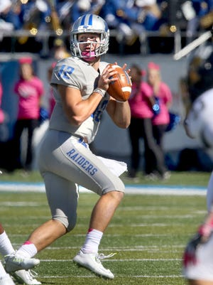 MTSU's quarterback Brent Stockstill (12) became the first MTSU quarterback to throw for 3,000 yards in a single season.
