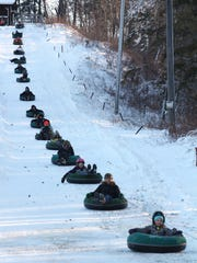 Tubers get pulled up the hill before going down the