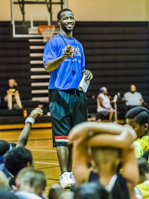 Justin Ingram, shown working a basketball camp in 2013, has been named the director of basketball operations at the University of Toledo.