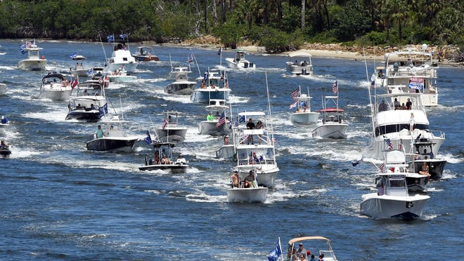 Hundreds of Trump supporters take to the Intracoastal Waterway in a show of support during a boat parade from Jupiter to Mar-a-Lago in Palm Beach on May 3 in West Palm Beach, Florida.