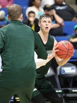 Mar 16, 2017; Tulsa, OK, USA; Michigan State Spartans guard Matt McQuaid (20) at BOK Center. Mandatory Credit: Brett Rojo-USA TODAY Sports