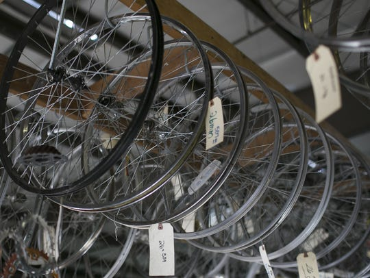Bicycle rims hang from the ceiling at the Rusty Spoke