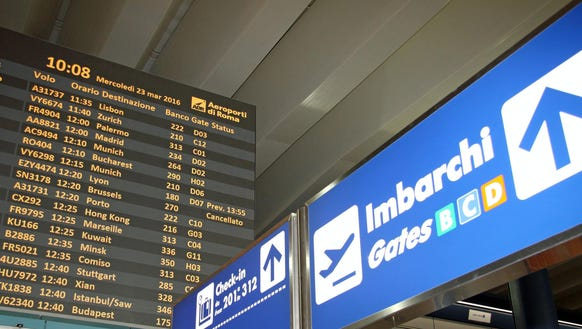 A departure board at Rome's major international airport
