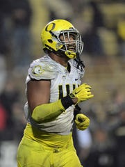 Oregon defensive lineman DeForest Buckner (44) reacts to the final play of the fourth quarter against Colorado at Folsom Field.