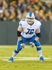 Detroit Lions right guard T.J. Lang awaits the snap against the Green Bay Packers at Lambeau Field on Nov. 6, 2017.