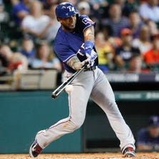 HOUSTON, TX - AUGUST 31: Elvis Andrus #1 of the Texas Rangers grounds out in the sixth inning against the Houston Astros at Minute Maid Park on August 31, 2014 in Houston, Texas. (Photo by Bob Levey/Getty Images)