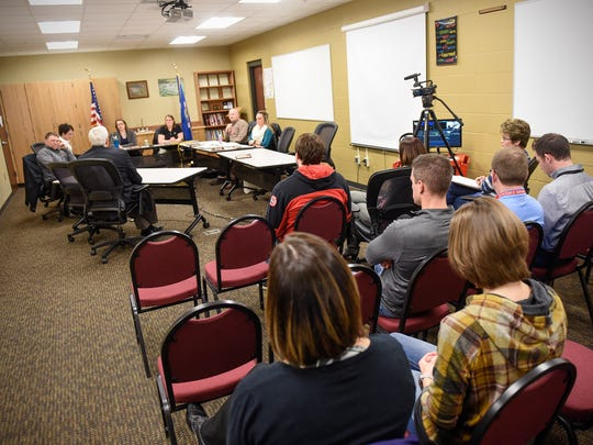 John Thein answers questions from Rocori School Board members during a meeting Tuesday, April 3, at the district offices in Cold Spring.