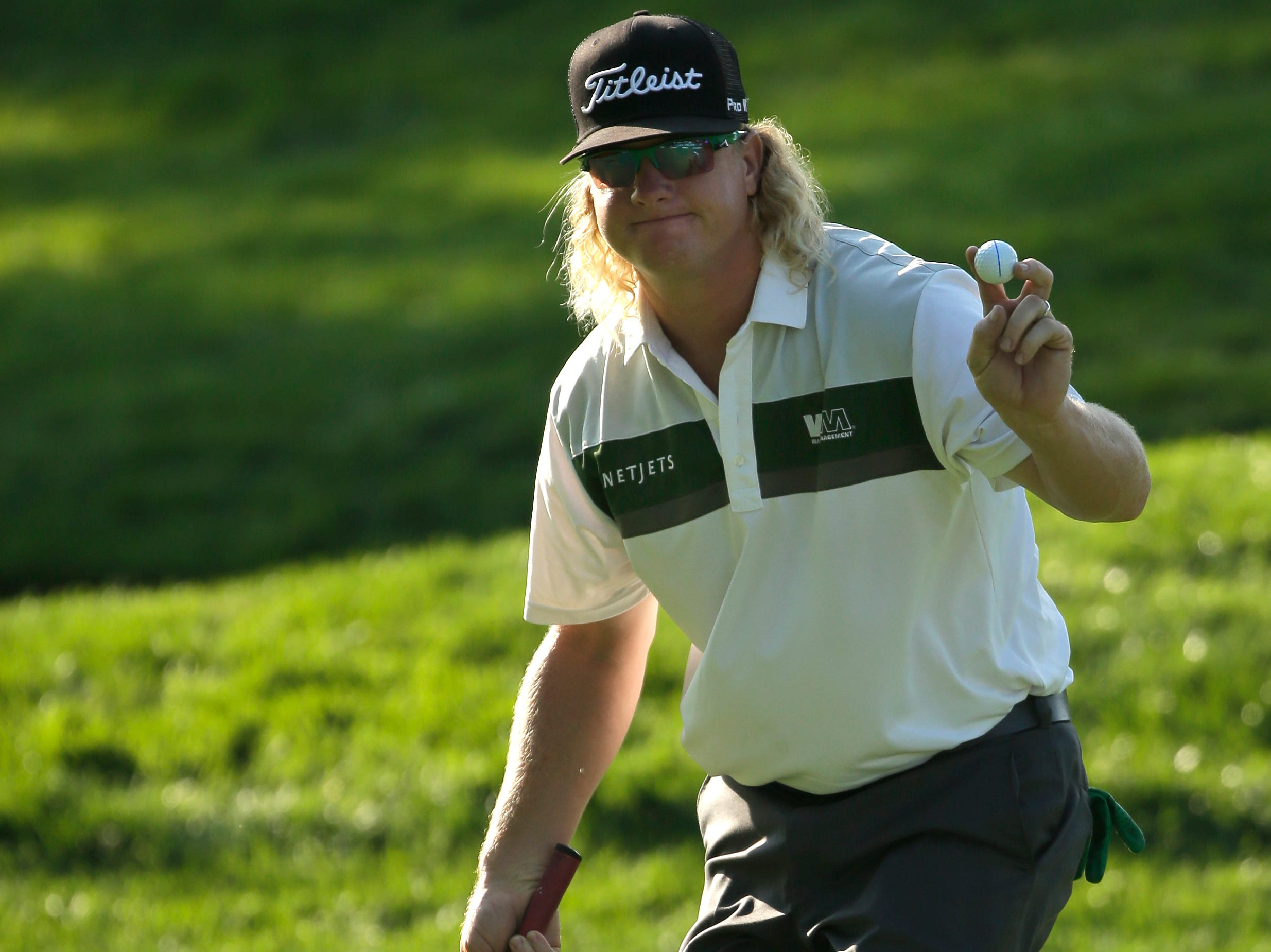 Charley Hoffman waves after a birdie putt on the 10th hole during the first round of the PGA Championship golf tournament at Oak Hill Country Club.