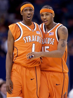 Syracuse players Hakim Warrick (1) and Carmelo Anthony celebrate a teammate's basket in the second half against Texas during the semifinals of the Final Four on Saturday, April 5, 2003, in New Orleans. (AP Photo/Al Behrman)