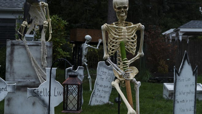 A house on Forest Street in Worcester has a decorated front lawn of Halloween decorations.