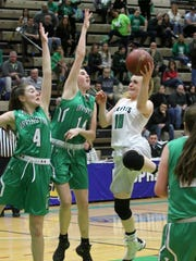 Seton Catholic Central's Ava McCann draws a foul on a runner Saturday in Troy. She went 9-for-10 in free throws and finished with 18 points.
