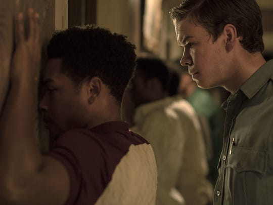 "Krauss (Will Poulter, right) interrogates Fred (Jacob Latimore) in ""Detroit."""