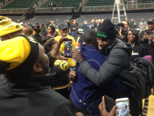 Iowa guard and Lansing native Anthony Clemmons greets