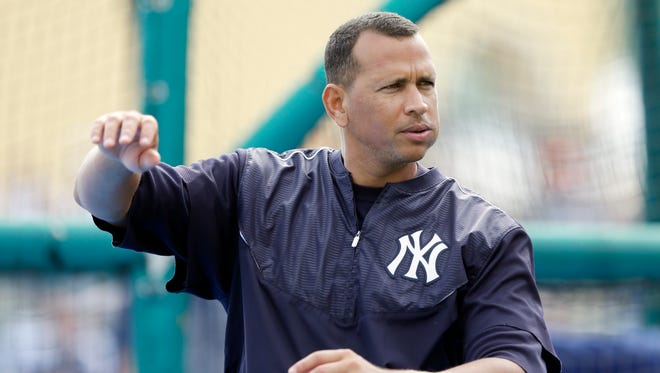 New York Yankees third baseman Alex Rodriguez warms up before a game against the Detroit Tigers in Lakeland, Fla., on March 20, 2015.