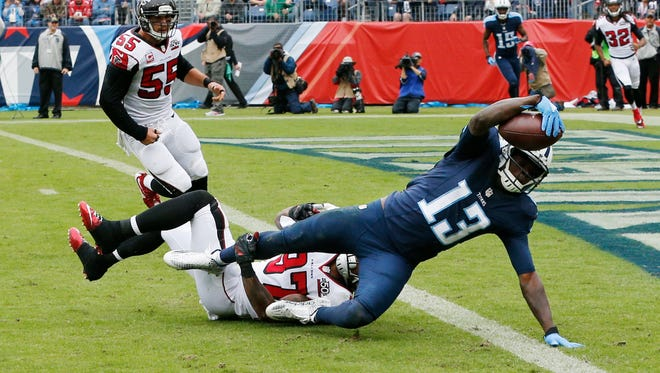 Titans wide receiver Kendall Wright (13) scores a touchdown on a 19-yard pass reception ahead of Falcons free safety Ricardo Allen (37) last season.