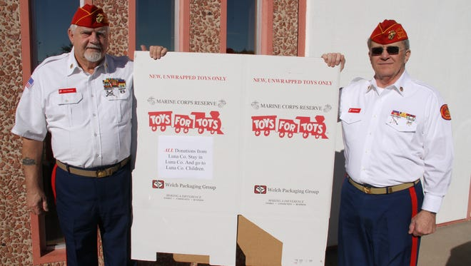 United States Marine Corps League members, Dick Hoezee, left, and Thom Barry show a Toys For Tots bin that will be set up at local retail stores and banks.