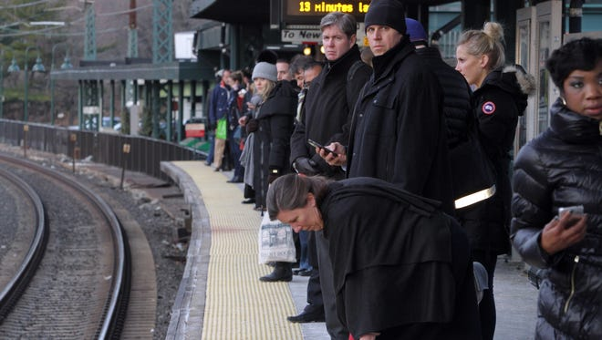 Commuters at Rye wait for their morning train to Grand Central.