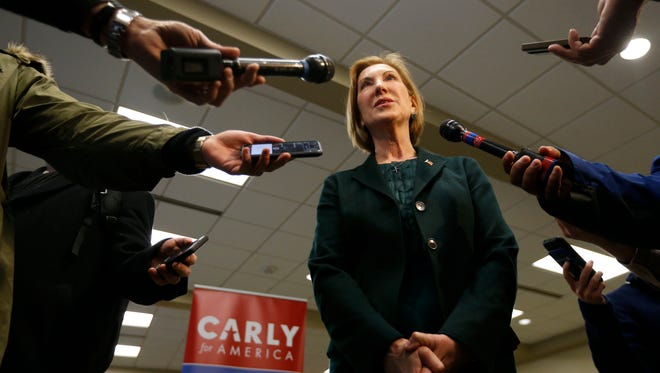 Republican presidential candidate Carly Fiorina  takes questions from members of the media Wednesday, Jan. 20, 2016, at a campaign stop at the Greater Des Moines Botanical Gardens.
