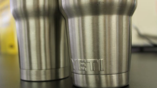 Stainless steel Yeti cups are flying off shelves as Floridians look for a tumbler that keeps their ice solid for days.