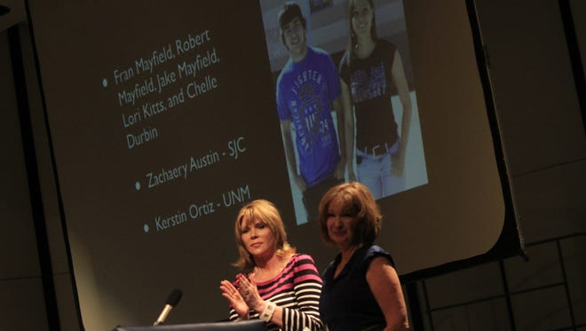 From left, Fran Mayfield and Lori Kitts present Kerstin Ortiz and Zachary Austin with the Cal Mayfield Scholarship during Piedra Vista High School's Senior Awards Ceremony on May 6 at the school in Farmington.