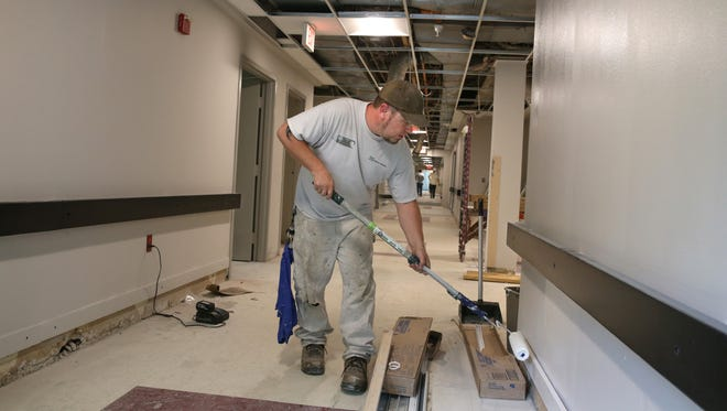 Keith Waite, Rochester, paints a hallway on the second floor at the new Cobbs Hill Manor adult care facility on Monroe Avenue in Rochester on May 26, 2016.